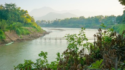 Old bamboo bridge across the river. Laos, Luang Prabang