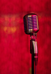 vintage microphone on red background