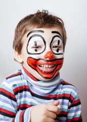 little cute boy with facepaint like clown, pantomimic expression
