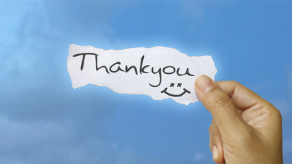 Holding thank you message note