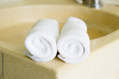 Stacked white spa towels