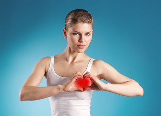 Attractive female forming heart shape over blue background