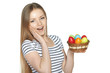 Surprised female holding basket with Easter eggs