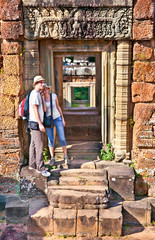 Couple at door of Prasat Pre Roup temple, Cambodia.