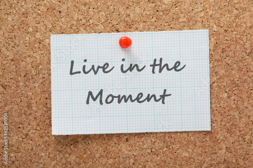Live in the Moment printed on a piece of graph paper