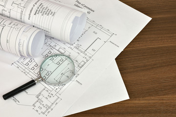 Construction drawings and magnifying glass