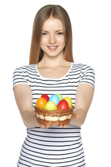 Female holding basket with Easter eggs