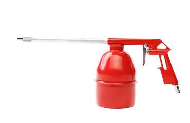 Spray gun of red color.