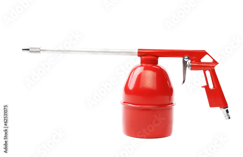 Spray gun of red color.