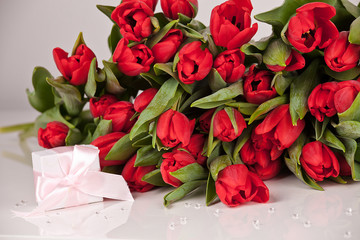 Picture of beautiful tulips with gift box, indoor decorations.