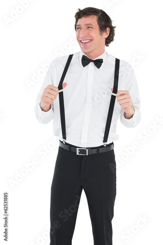 Happy man stretching suspenders
