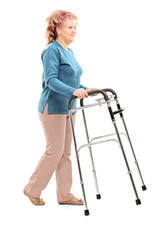 Mature woman walking with walker