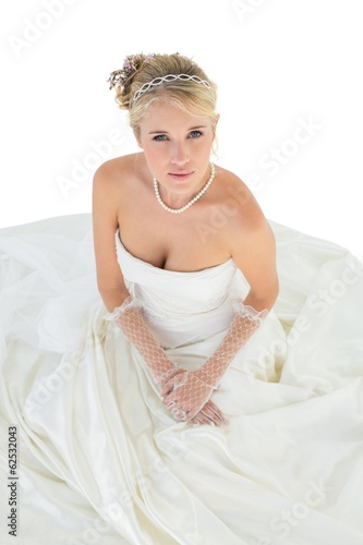 Elegant bride in wedding dress over white background