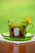 Tea cup with fresh lemons, closeup photo