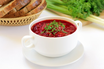 Red borscht soup with dill