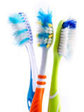 Old used colorful toothbrushes isolated on white background