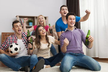 Group of friends enjoying soccer in TV