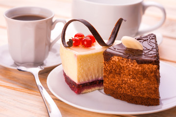 delicious chocolate and cheesecake with cup of coffee