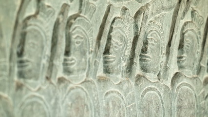 Ancient carvings on the walls of Angkor Wat close up. Cambodia