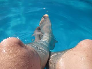 my legs in blue sea