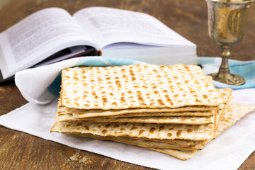 Matzo and wine for passover celebration on a wooden table
