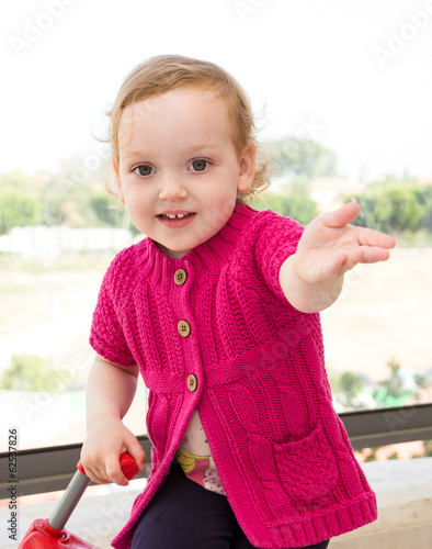 Adorable little girl smiling and looking at camera