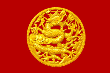 Golden Chinese dragon on red wood background