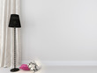 Black floor lamp against a white background