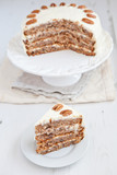 Piece of Hummingbird cake with pecans and cream cheese frosting