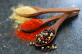 vibrant spices in wooden spoons