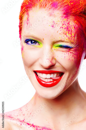 Portrait of beautiful girl with bright makeup closeup