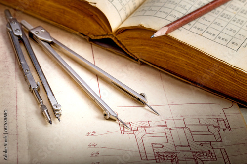 Old engineering drawing and book