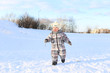 baby running outdoors in winter