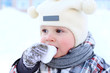 baby eating snow