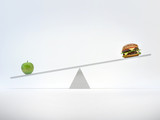 Scales with an apple and a hamburger.