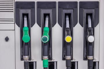 row of gas pump nozzles