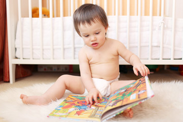 baby age of 1 year reading book