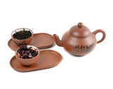 clay teapot and cups with tea