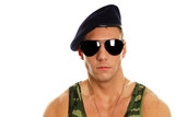 Portrait of young military man at sunglasses