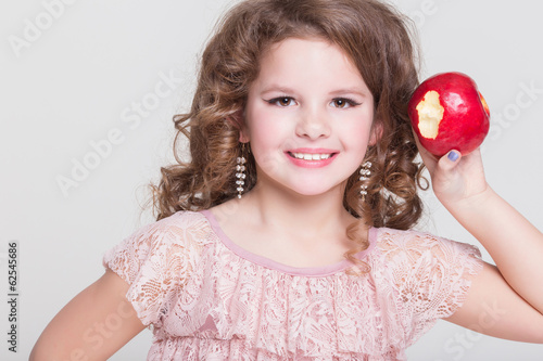 Child little girl eating apple healthy bio fruits