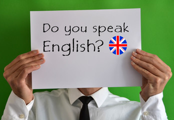 Businessman showing a sheet with text Do you speak English
