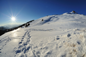 Dolomiti, Val di Fiemme, Passo di Lavazè, sole e neve