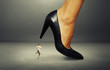 businesswoman under big heel over dark