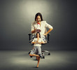 woman sitting on the office chair and screaming