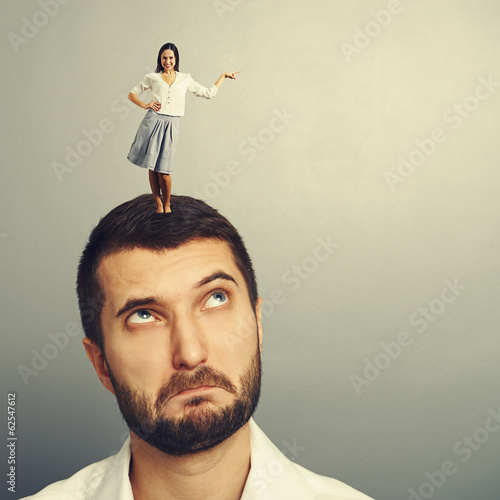 man looking at small woman on the head
