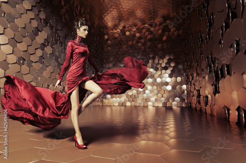 Leinwanddruck Bild Glamorous woman with wavy dress