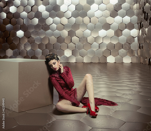 Conceptual photo of woman in the golden room