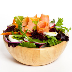 Smoked salmon salad with red onion, egg, carrots and radishes