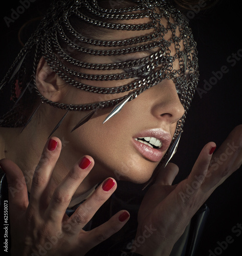 Sensual woman with chain mask