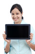 Happy young business woman showing tablet